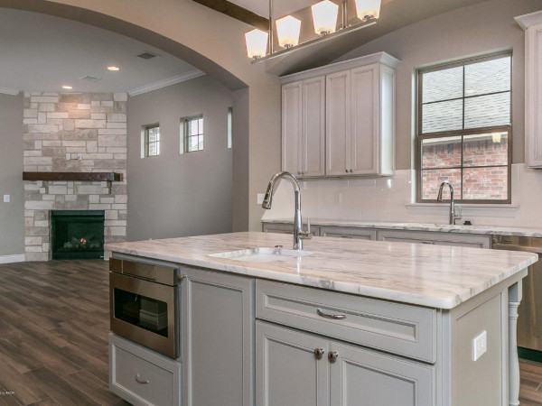 Kitchen with natural marble island countertop